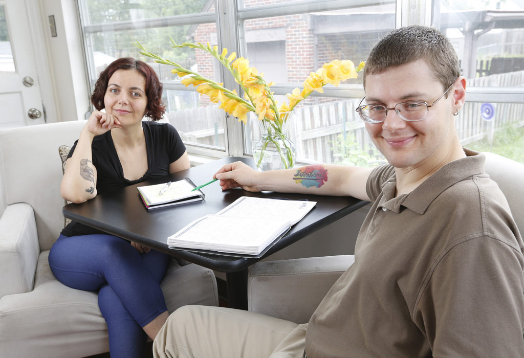 Photo of Gleb Tsipursky with his wife and business partner, Agnes Vishnevkin (Photo by Adam Cairns, The Columbus Dispatch)